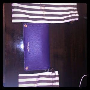 Purple clutch with strap purse/wallet